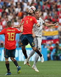 MOSCOW, July 1, 2018  Sergio Busquets (C) of Spain competes for a header with Artem Dzyuba (R) of Russia during the 2018 FIFA World Cup round of 16 match between Spain and Russia in Moscow, Russia, July 1, 2018. (Credit Image: © Cao Can/Xinhua via ZUMA Wire)