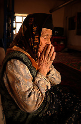 Ali Ipak 's mother sits inside the warmth of their home  December 12, 2005 in central Turkey, Konya in Kutoren district, about 400 kilometers from Ankara.  (Ami Vitale)
