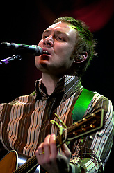 David Grey plays a Concert to a sellout Sheffield Hallam FM Arena  November 29 2002 Friday<br /><br />Copyright Paul David Drabble<br />Freelance Photographer<br />07831 853913<br />0114 2468406<br />www.pauldaviddrabble.co.uk<br /> [#Beginning of Shooting Data Section]<br />Nikon D1 <br /> 2002/11/29 21:54:35.5<br /> JPEG (8-bit) Fine<br /> Image Size:  2000 x 1312<br /> Color<br /> Lens: 80-200mm f/2.8-2.8<br /> Focal Length: 185mm<br /> Exposure Mode: Manual<br /> Metering Mode: Spot<br /> 1/125 sec - f/2.8<br /> Exposure Comp.: 0 EV<br /> Sensitivity: ISO 400<br /> White Balance: Auto<br /> AF Mode: AF-S<br /> Tone Comp: Normal<br /> Flash Sync Mode: Not Attached<br /> Color Mode: <br /> Hue Adjustment: <br /> Sharpening: Normal<br /> Noise Reduction: <br /> Image Comment: <br /> [#End of Shooting Data Section] David Grey plays a Concert to a sell out Sheffield Hallam FM Arena November 29 2002 Friday<br /> <br /> Copyright Paul David Drabble<br /> Freelance Photographer<br /> 07831 853913<br /> 0114 2468406