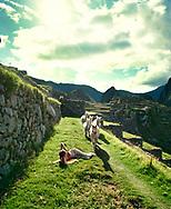 Enjoying the sun and llamas at  Machu Picchu, Peru<br /><br />Photo by Dennis Brack bb72