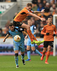 11 March 2017 - Skybet Championship - Wolverhampton Wanderers v Rotherham United - David Edwards of Wolverhampton Wanderers climbs on the back of Anthony Forde of Rotherham United - Photo: Paul Roberts / Offside