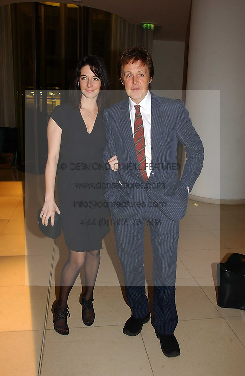 SIR PAUL McCARTNEY and his daughter MARY McCARTNEY at a Burns Night dinner in aid of CLIC Sargent and Children's Hospice Association Scotland held at St.Martin's Lane Hotel, St.Martin's Lane, London on 25th January 2007.<br /><br />NON EXCLUSIVE - WORLD RIGHTS