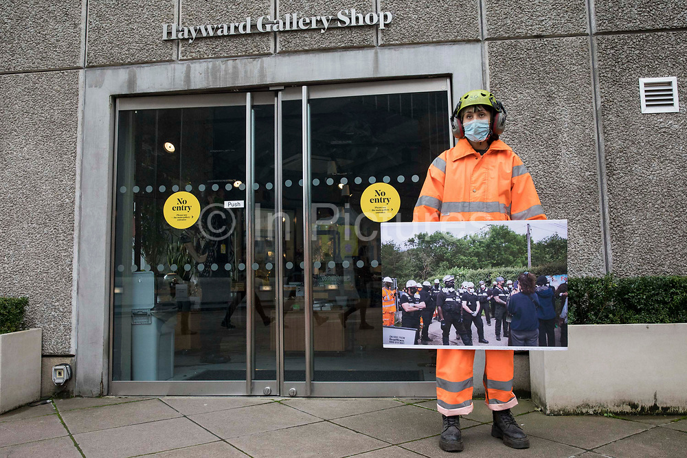 An activist dressed as a HS2 worker takes part in a HS2 Chainsaw Massacre protest outside the Among The Trees exhibition at the Hayward Gallery on 30 October 2020 in London, United Kingdom. The protest was intended to highlight both the daily environmental destruction being wrought for the controversial HS2 high-speed rail project and instances of violence and brutality by security guards and bailiffs working on behalf of HS2 Ltd.