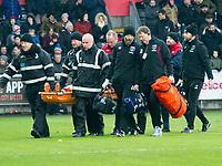 Football - 2017 / 2018 Premier League - Swansea City vs. West Ham United<br /> <br /> Winston Reid of West Ham Unitedis carried off the field injured, at the Liberty Stadium.<br /> <br /> COLORSPORT/WINSTON BYNORTH