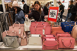 © Licensed to London News Pictures. 26/12/2016. Customers buying Michael Kors ladies handbag department of Selfridges store in Oxford Street for the start of the stores Boxing Day sales. London, UK. Photo credit: Ray Tang/LNP