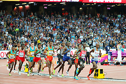 London, August 12 2017 . Mo Farah, Great Britain, keeps keeps pace with Cyrus Rutto, Kenya, in the men's 5000m final on day nine of the IAAF London 2017 world Championships at the London Stadium. © Paul Davey.