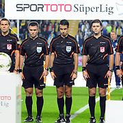 Referee Mete Kalkavan (C) during their Turkish superleague soccer match Fenerbahce between Torku Konyaspor at the Sukru Saracaoglu stadium in Istanbul Turkey on Saturday 04 October 2014. Photo by Kurtulus YILMAZ/TURKPIX