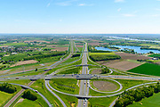 Nederland, Gelderland, Over-Betuwe, 13-05-2019; knooppunt Valburg. gezien naar het Oosten. Kruising A50 (vlnr) en A15, infrabundel met Betuweroute (links).<br /> Valburg junction. Junction A50 and A15, infrastructure bundle with Betuwe Route.<br /> <br /> luchtfoto (toeslag op standard tarieven);<br /> aerial photo (additional fee required);<br /> copyright foto/photo Siebe Swart
