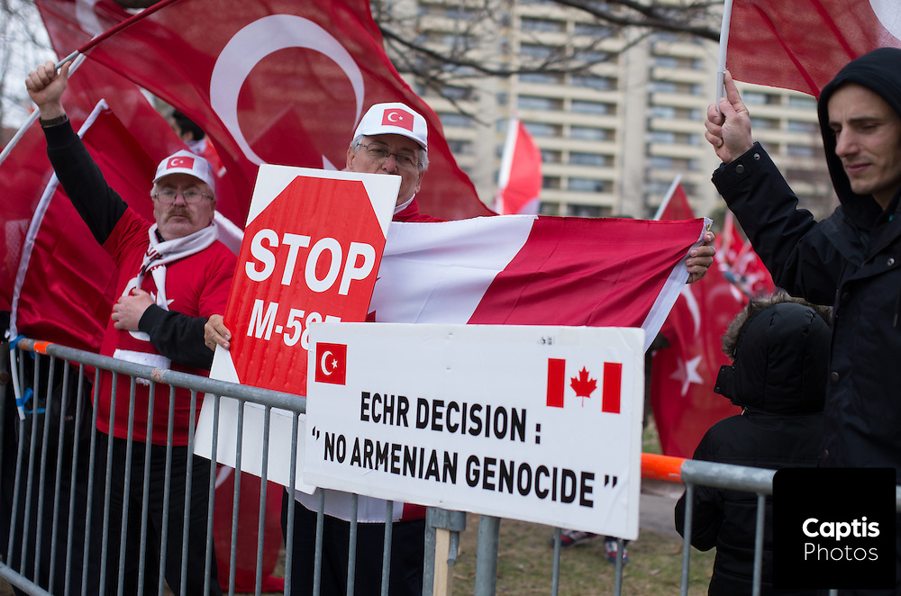 Thousands of Armenians and supporters marched from Parliament Hill to the Turkish embassy in Ottawa to mark the 100th anniversary of the Armenian genocide. The march was met by a Turkish counter-protest in MacDonald Gardens park, outside the embassy. The two groups were separated by temporary fences and a heavy police presence. Both sides exchanged words and gestures, but the demonstration remained peaceful. April 24, 2015<br /> <br /> Captis Photos/Brendan Montgomery
