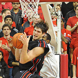 Rutgers Scarlet Knights forward Gilvydas Biruta (55) grabs a defensive rebound during Rutgers' 67-60 upset victory over #8 UConn in NCAA Big East Basketball action at the Louis Brown Athletic Center in Piscataway, N.J. on Jan 7, 2012.