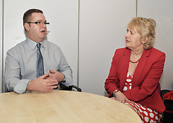 Remploy candidate George Martin-Quinn talks to Scottish Government Minister Minister for the Environment Roseanna Cunningham on her visit to the to the charity's Edinburgh offices.<br /> <br /> © Dave Johnston/ EEm