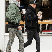 NLD/Amsterdam/20150131 - Adam Lambert van de Popgroep Queen en zijn vriend Saul Koskinen wandelend door Amsterdam - Adam Lambert of the popgroup Queen strolling trough Amsterdam with boyfriend Saul Koskinen