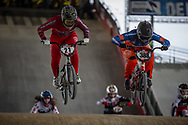 #21 (REYNOLDS Lauren) AUS and #388 (BAAUW Judy) NED at Round 2 of the 2018 UCI BMX Superscross World Cup in Saint-Quentin-En-Yvelines, France.