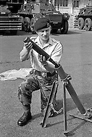 Colonel Malcolm Mackenzie-Orr, RAOC, Royal Army Ordnance Corps, demonstrating a Provisional IRA DIY rocket launcher captured in a planned search in Belfast, N Ireland, UK. The weapon was constructed from lavatory pipes and joints as used by plumbers. A few months later Mackenzie-Orr defused a massive van bomb beside a Belfast telephone exchange for which he was awarded the George Cross. After he had foiled the attempt to destroy the exchange, it was feared he might become a terrorist target and he was re-assigned to the weapons research establishment in Woomera, South Australia. He left the military having achieved the rank of brigadier. He died 16th December 2007 in Australia. 197307050472a.<br /> <br /> Copyright Image from Victor Patterson, 54 Dorchester Park, Belfast, UK, BT9 6RJ<br /> <br /> t1: +44 28 9066 1296 (from Rep of Ireland 048 9066 1296)<br /> t2: +44 28 9002 2446 (from Rep of Ireland 048 9002 2446)<br /> m: +44 7802 353836<br /> <br /> e1: victorpatterson@me.com<br /> e2: victorpatterson@gmail.com<br /> <br /> The use of my copyright images is subject to my Terms & Conditions.<br /> <br /> It is IMPORTANT that you familiarise yourself with them. They are available on my website at www.victorpatterson.com.<br /> <br /> None of my copyright images may be used on a website unless they are visibly watermarked, i.e. © Victor Patterson within the body of the visible image. Metadata denoting my copyright must NOT be deleted. <br /> <br /> Web use (maximum size - 400 kb) is extra at currently recommended NUJ rates.