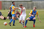 Waitakere United's Jake Porter, centre, and Southern United's Ross Howard, right, compete for the ball watched by Southern United's Eric Molloy, left, in the Stirling Sports Premiership football match, Peter Johnstone Park, Mosgiel, New Zealand, Saturday, January 21, 2017. © Copyright photo: Adam Binns / www.photosport.nz