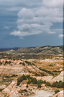 Painted Canyon Panorama. Theodore Roosevelt National Park. Composite of 7 of 9 images taken with a Nikon D3 camera and 85 mm f/2.8 PC-E lens (ISO 200, 85 mm, f/16, 1/40 sec). Raw images processed with Capture One Pro (BM-02 Teton Style). Composite generated with  AutoPano Giga Pro.