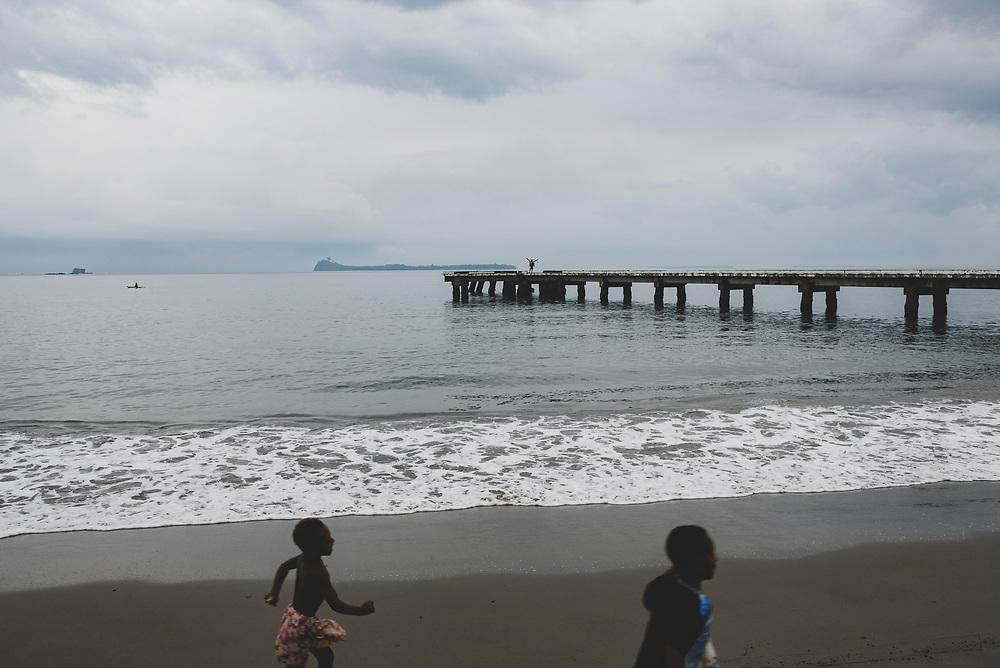 Children run on the beach in Aitape, Sundaun Province, Papua New Guinea.<br /><br />(July 20, 2017)