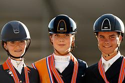 Podium Juniors, Van Peperstraten Daphne, Rockx Thalia, Luiten Marten, NED<br /> Nederlands Kampioenschap Dressuur <br /> Ermelo 2018<br /> © Hippo Foto - Dirk Caremans<br /> 28/07/2018