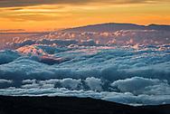 Sea of clouds at sunset seen from the summit of Mauna Kea, (looking toward Haleakala on neighboring island of Maui, Big Island of Hawai'i, Hawaii