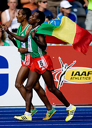 Winner Kenenisa Bekele and Ali Abdosh of Ethiopia celebrate after the men's 5000m Final during the day nine of the 12th IAAF World Athletics Championships at the Olympic Stadium on August 23, 2009 in Berlin, Germany. (Photo by Vid Ponikvar / Sportida)
