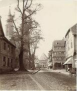 Incredible Photos Capture Everyday Life of Germany in the Early 1880s <br /> <br /> Carl Curman (1833 – 1913) was a Swedish physician and a scientist - as well as a prominent amateur photographer. He did a lot of travelling abroad in Europe, mainly to study health resorts, but also to study art and architecture. These  Incredible photos  were taken in Germany in the early 1880s when he traveled there.<br /> <br /> Photo shows:  The Historic Town of Goslar in Germany (Towers of Marktkirche Church behind the tree), 1882<br /> ©Swedish National Heritage Board/Exclusivepix Media