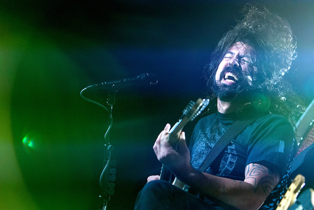 Dave Grohl gives an energetic performance with the Foo Fighters at Xcel Energy Center in St. Paul August 22, 2015.