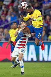 March 21, 2019 - Orlando, FL, U.S. - ORLANDO, FL - MARCH 21: United States midfielder Christian Pulisic (10) battles with Ecuador defender Gabriel Achilier (21) in game action during an International friendly match between the United States and Ecuador on March 21, 2019 at Orlando City Stadium in Orlando, FL. (Photo by Robin Alam/Icon Sportswire) (Credit Image: © Robin Alam/Icon SMI via ZUMA Press)