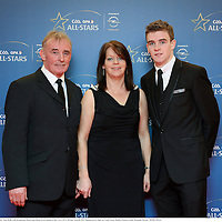 8 November 2013; Clare hurler Tony Kelly with his parents Moira and Donal arrive ahead of the GAA GPA All-Star Awards 2013 Sponsored by Opel, at Croke Park, Dublin. Picture credit: Brendan Moran / SPORTSFILE
