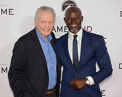 October 12, 2017 - Los Angeles, California, USA - JON VOIGHT and DJIMON HOUNSO appears on the Red Carpet for the 'Same Kind Of Different As Me' Los Angeles Premiere at the Westwood Village Theatre. (Credit Image: © Billy Bennight via ZUMA Wire)