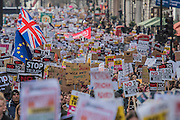 Banners and placards on Piccadilly - A march against racism and to ban the ban (against immigration from certain countries to the USA) is organised by Stand Up To Racism and supported by Stop the War and several unions. It stated with a rally at the US Embassy in grosvenor Square and ended up in Whitehall outside Downing Street. Thousands of people of all races and ages attended. London 04 Feb 2017.