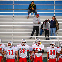 101014       Cable Hoover<br /> <br /> The Shiprock Chieftains line up on the sideline as they prepare to face off against the Thoreau Hawks Friday at Thoeau High School.
