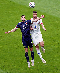 Scotland's Ryan Christie (left) and Czech Republic's Ondrej Celustka battle for the ball in the air during the UEFA Euro 2020 Group D match at Hampden Park, Glasgow. Picture date: Monday June 14, 2021.