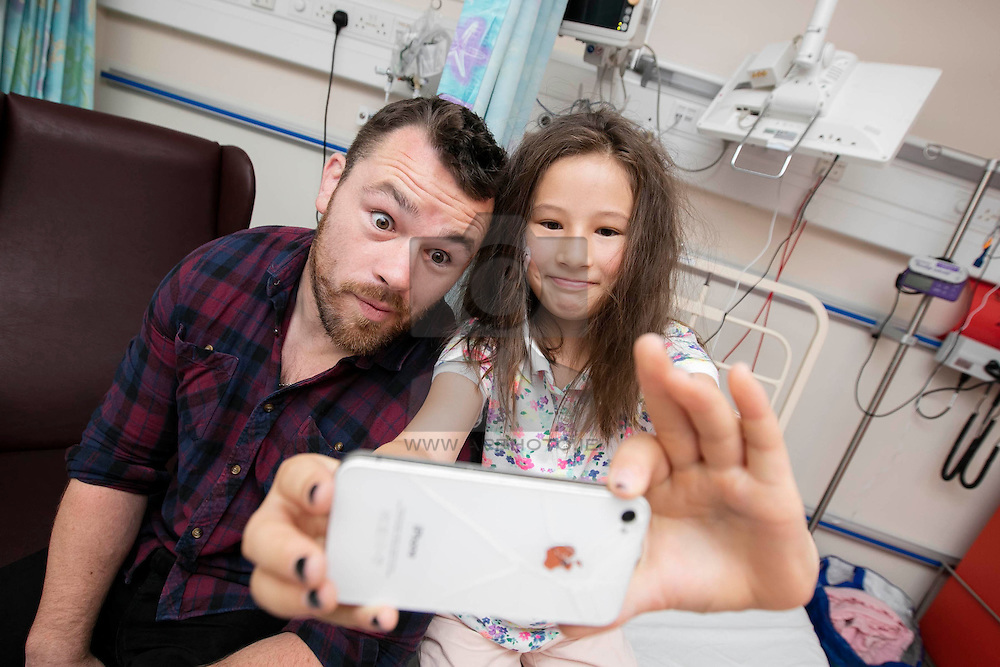 Repro Free:<br /> Ireland and Leinster rugby star Cian Healy is pictured with Naoise Heather (age 9) from Balbriggan in Temple Street Children's Hospital at the launch of the King Koil Sleeptember Campaign. Encouraging the nation to join the  #BedHeadSelfie initiative in aid of Temple Street Children's Hospital. Picture Andres Poveda
