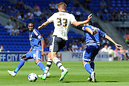 Fulham's Dan Burn (33) clears from Cardiff's Kagisho Dikgacoi (l) and Peter Whittingham. Skybet football league championship match, Cardiff city v Fulham at the Cardiff city stadium in Cardiff, South Wales on Saturday 8th August  2015.<br /> pic by Carl Robertson, Andrew Orchard sports photography.