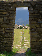 View of Machu Picchu through a doorway from Llactapata, Peru. Llactapat is presumed to be on an Incan outpost near Machu Picchu.