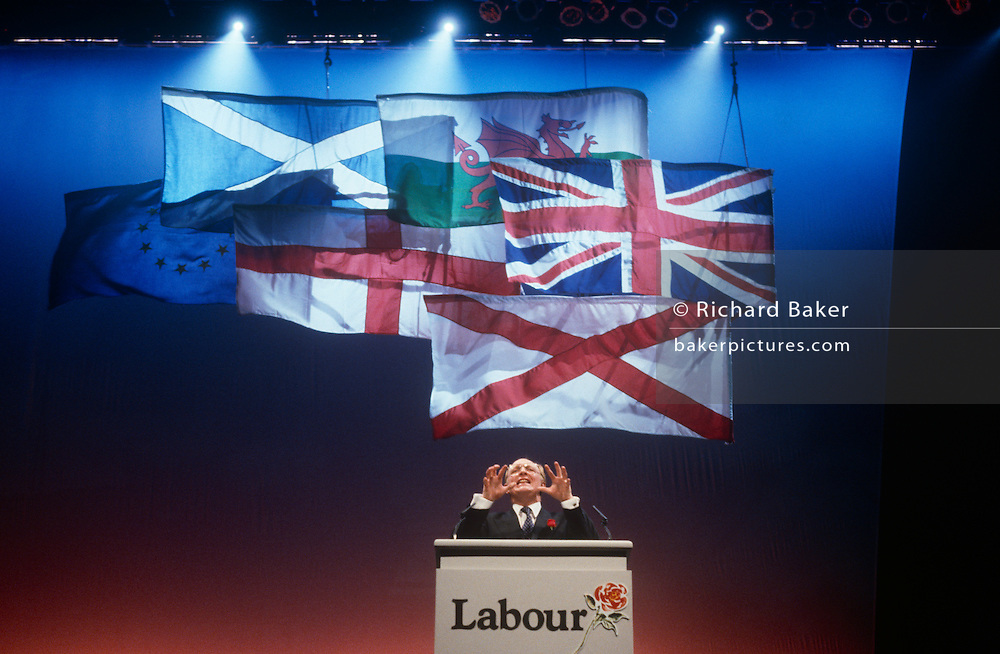 """Leader of the Labour party, Neil Kinnock makes his infamous speech during the Labour Party election rally on 1st April 1992 in Sheffield, England. In the 1992 election, Labour made considerable progress – reducing the Conservative majority to just 21 seats. It came as a shock to many when the Conservatives won a majority, but the """"triumphalism"""" perceived by some observers of a Labour party rally in Sheffield (together with Kinnock's performance on the podium) may have helped put floating voters off."""