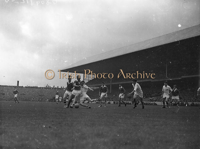 Galway's A.Ryan, tries to get a foot to the ball but Cork's Coughlan kicks the ball towards during the All Ireland Minor Gaelic Football Final Cork v. Galway in Croke Park on the 26th September 1960.