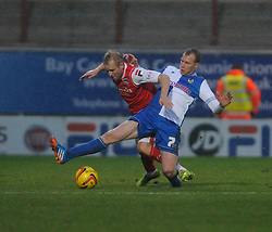 Bristol Rovers' David Clarkson tackles Morecambe's Robbie Threlfall - Photo mandatory by-line: Dougie Allward/JMP - Tel: Mobile: 07966 386802 14/12/2013 - SPORT - Football - Morecombe - Globe Arena - Morecombe v Bristol Rovers - Sky Bet League Two