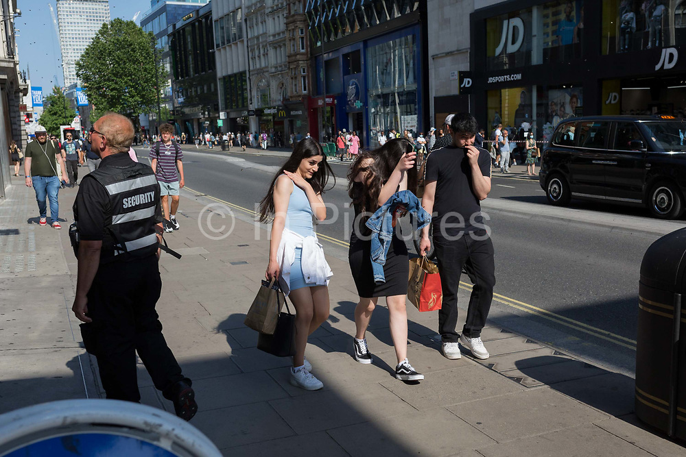 A swarm of bees disrupt worried shoppers on Londons Oxford Street on the day that UK Prime Minster, Boris Johnson announced in parliament a major easing of Coronavirus pandemic restrictions on July 4th next week, including the re-opening of pubs, restaurants, hotels and hairdressers in England, on 23rd June 2020, in London, England. The three month two metre social distance will be also reduced to one metre plus but in the last 24hrs, a further 171 have died from Covid, bringing the UK total to 42,927.