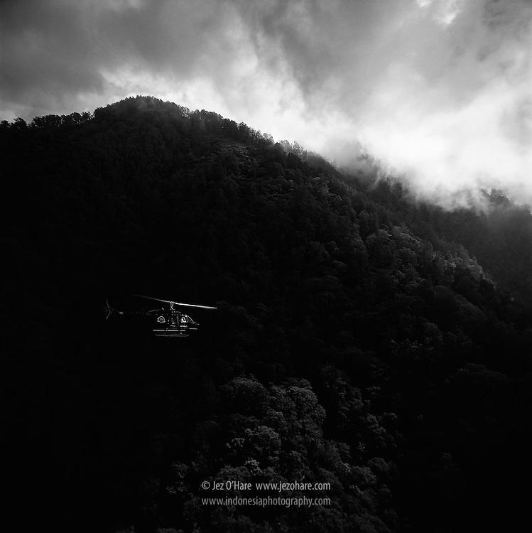 Air Bali/Derazona Air Service Bell 206 helicopter leaving lake Batur, Bali, Indonesia.