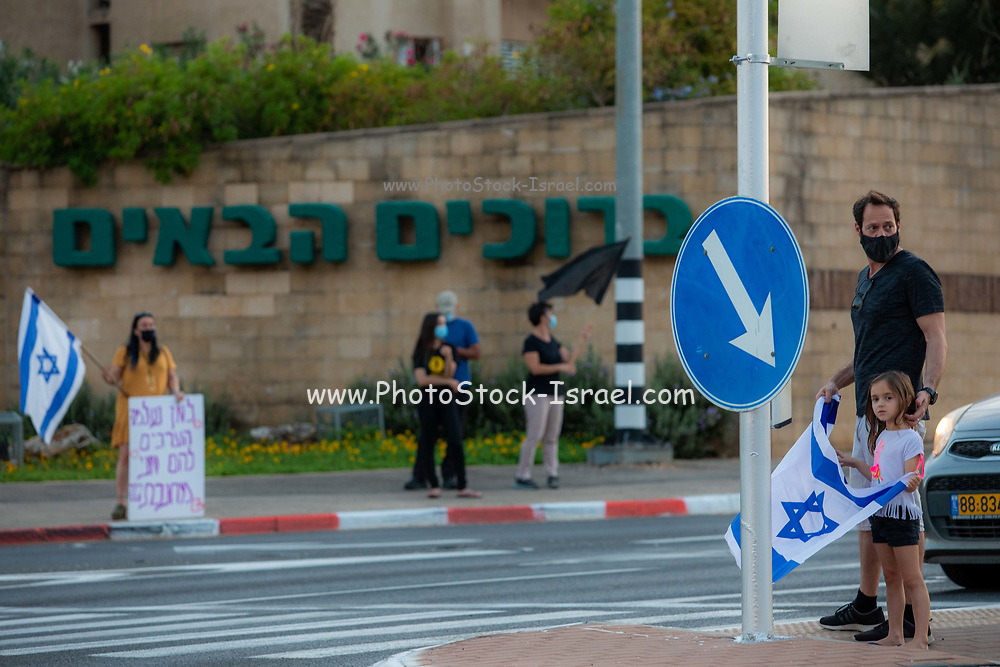In a futile attempt to stop the mounting protests against the illegality of a prime minister facing 3 charges of bribery and corruption and his bloated and corrupt government and ministers, Israeli Prime Minister Benjamin (Bibi) Netanyahu, has imposed a [unnecessary] countrywide lockdown limiting mobility to 1000 meters from residence. This lockdown has had the opposite effect as hundreds of smaller demonstrations have broken out at every major junction and over every bridge and overpass and virtually every city square. The Israeli Police, as ordered, are doing their utmost to prevent these demonstration and register the protesters. Photographed at Kfar Yona Junction on route 57, Israel on Saturday October 3rd 2020