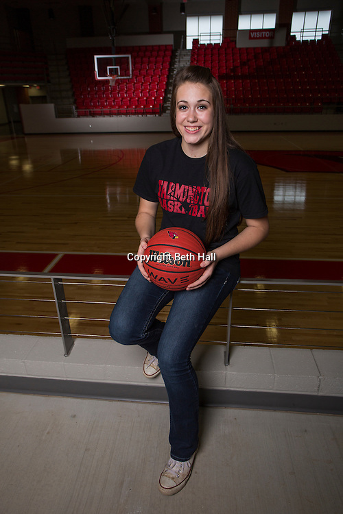 Ella Wilson stands on the basketball court at Cardinal Arena on Tuesday, May 5, 2015, in Farmington, Arkansas.<br /> <br /> Photo by Beth Hall