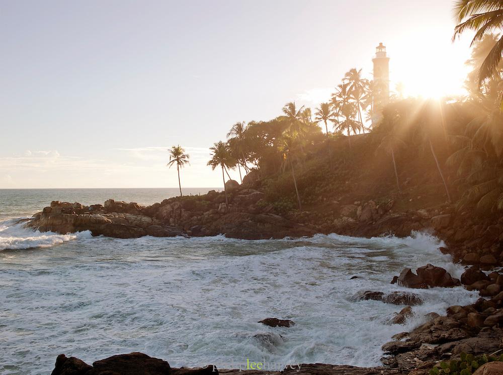 Kovallam Lighthouse and rocks on the coast, Kerala, India