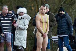 © Licensed to London News Pictures. 25/12/2020. Sutton Coldfield, West Midlands, UK. Christmas Day swim, Blackroot pool, Sutton Coldfield, West Midlands. The Christmas Day swim has become an annual tradition with swimmers of all ages taking part in the early morning chilly festive dip with temperatures only just above freezing this year. Participants arrive from 9am, to get ready for the plunge into the water at 10am. Photo credit: Dave Warren/LNP