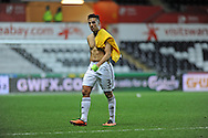 Dissappointed Swansea City Captain Neil Taylor can't hide his emotions as he walks off the field at full time.<br /> UEFA Europa league match, Swansea city v FC Kuban Krasnodar at the Liberty Stadium in Swansea, South Wales on Thursday 24th October 2013. pic by Phil Rees, Andrew Orchard sports photography,