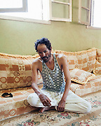 Negi Helal Khamis was injured in 1998 at El Harabi when he and another man prepared a fire for lunch. After the explosion Negi was left deaf in one ear, blind in both eyes and with shrapnel injuries to his left arm. The other man was killed.