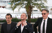 Actor Albert Dupontel, Actor Benoît Poelvoorde, Director Benoît Delepine at Le Grand Soir photocall at the 65th Cannes Film Festival France. Tuesday 22nd May 2012 in Cannes Film Festival, France.