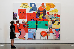 """© Licensed to London News Pictures. 06/10/2021. LONDON, UK. """"Current Affairs, N1"""", 2002, by Hervé Télémaque. Preview of 'A Hopscotch of the Mind' by Hervé Télémaque at the Serpentine Gallery.  It is the Haitian-French artist's first exhibition in the UK with works from the late 1950s until the present day which describe racism, imperialism and colonialism.  The show runs 7 October 2021 to 30 January 2022.  Photo credit: Stephen Chung/LNP"""