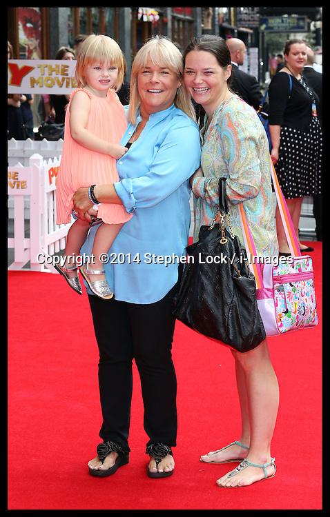 Image licensed to i-Images Picture Agency. 13/07/2014. London, United Kingdom. Actress Linda Robson with her daughter and grand-daughter at the World premiere of Pudsey The Dog : The Movie in London.  Picture by Stephen Lock / i-Images