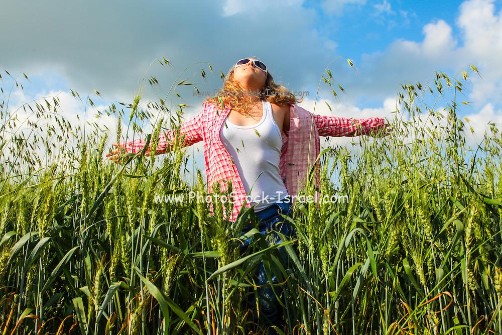 Portrait of a 16 year old teen girl in a wheat field Model released